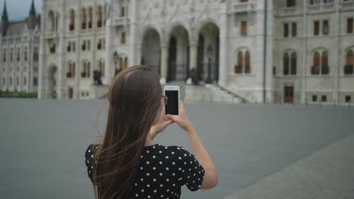 Vacation in Budapest Hungary Woman Takes Photo of Parliament