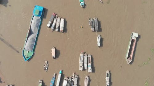 Aerial: rotating panorama over Cai Rang floating market Can Tho Vietnam