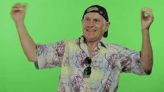 Thumbnail for Senior Man Tourist in Colorful Shirt Emotionally Celebrating. Handsome Old Man