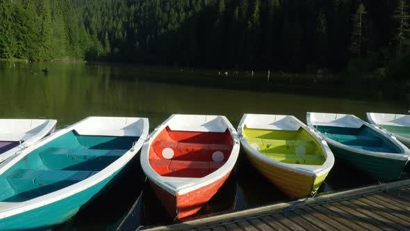 Thumbnail for Bright Multicolored Boats On A Lake Shore