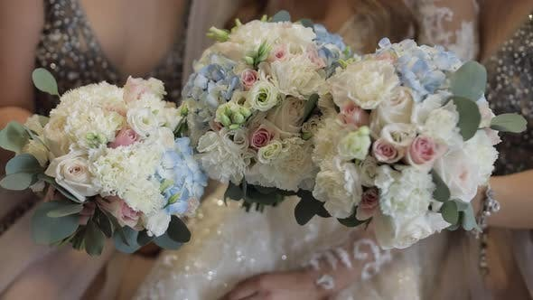 Thumbnail for Faceless Bride and Two Bridesmaids Posing with Bouquets. Wedding