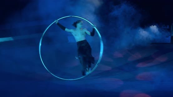 Thumbnail for Stunning Athleticism Professional Gymnast Is Spinning in a Wheel Circus