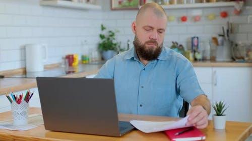 Beared Mature Man Doing Office Work at Home