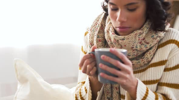 Thumbnail for Sick Young Woman in Scarf Drinking Hot Tea at Home 4