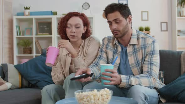 Thumbnail for Girl and Guy Watching TV
