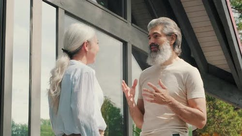 Cheerful Senior Couple Talking Outside