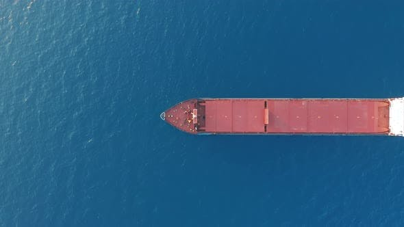 Thumbnail for Aerial View, Red Deck Cargo Ship Sailing on Open Sea