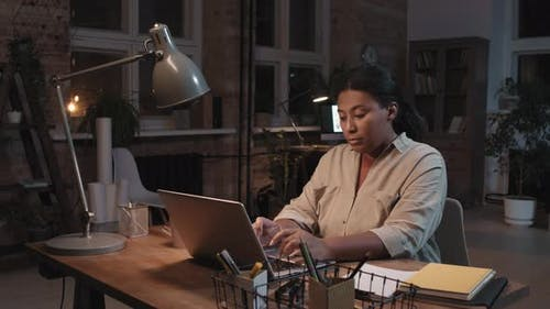 Afro Woman Working On Laptop At Night
