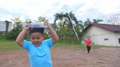 Kids Playing With Kite