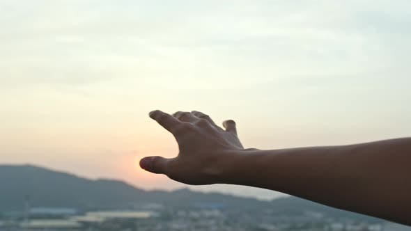 Thumbnail for Hand touch the sunset