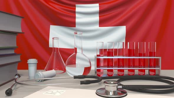 Clinic Laboratory Equipment on Swiss Flag Background