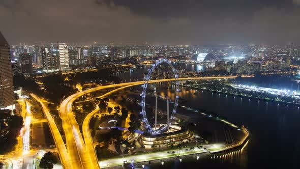 Thumbnail for Road Highway To the Night Cityscape Skyline at Singapore with Ferris Wheel
