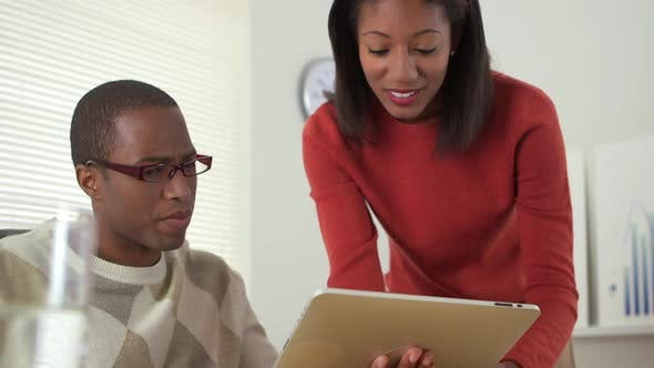 Thumbnail for African American business workers using tablet computer