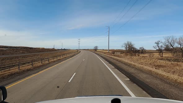 POV View From the Cab of a Truck Driving on a Highway