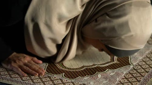Woman in Hijab Prostrating on Prayer Rug, Obligatory Religious Ritual, Worship