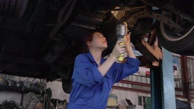 Woman checking car