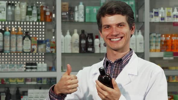 Thumbnail for Cheerful Pharmacist Showing Thumbs Up While Working at the Drugstore