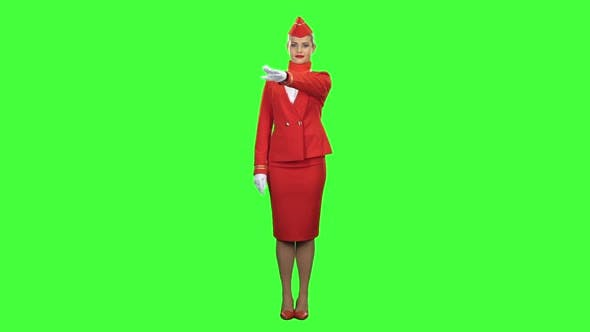 Thumbnail for Stewardess Shows with a Gesture That Everyone Would Stay on the Ground. Green Screen