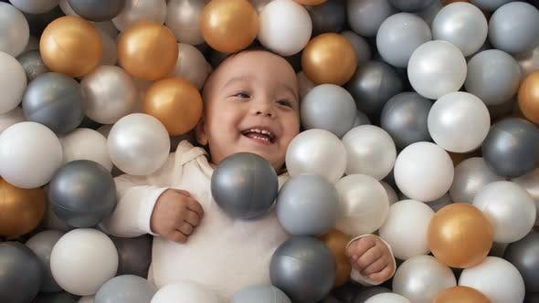 Thumbnail for Delighted Asian Baby Chilling Out in Ball Pit