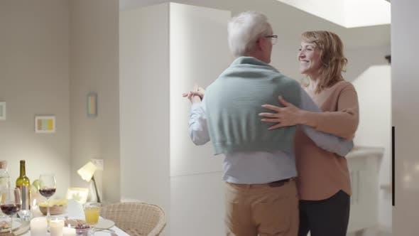 Thumbnail for Romantic Senior Couple Dancing at Home
