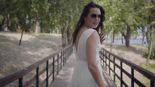 Thumbnail for Portrait Glamorous Brunette Young Girl Wearing Sunglasses and Long White Summer Fashion Dress