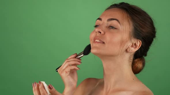 Thumbnail for Gorgeous Young Woman Applying Makeup on Green Background 1080p