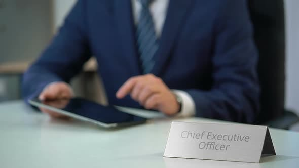 Thumbnail for Chief Executive Officer of Company Working on Tablet Pc, Viewing Files on Screen