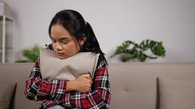 Sad girl hug pillow