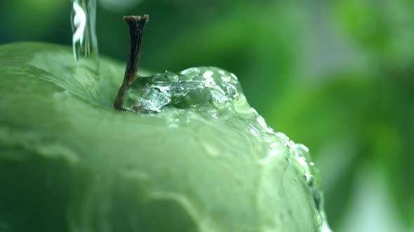 Water splashing on apple in slow motion; shot on Phantom Flex 4K at 1000 fps