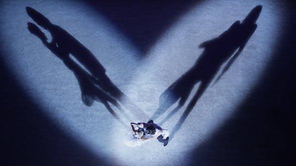 Thumbnail for Figure Skaters Performing Love Dance in Blue Light