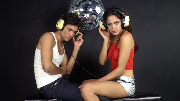 Thumbnail for Young Couple Dancing With Retro Headphones 3