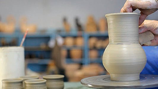 Potter Makes Pitcher From Clay