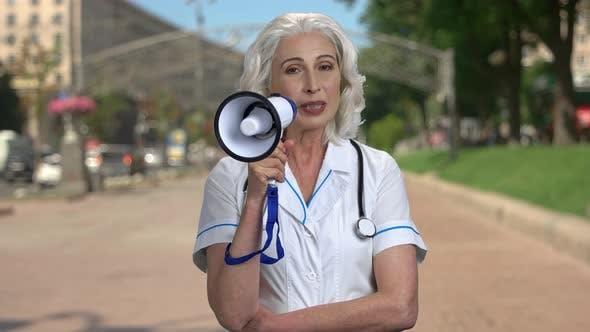 Female Doctor Making an Announcement Through Megaphone