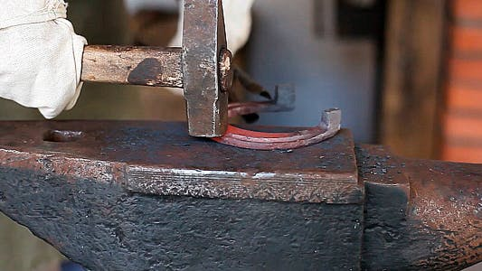 Thumbnail for Blacksmith Forges a Horseshoe in a Smithy