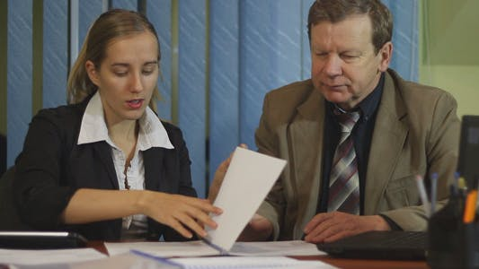 Thumbnail for Business People Work with Business Report