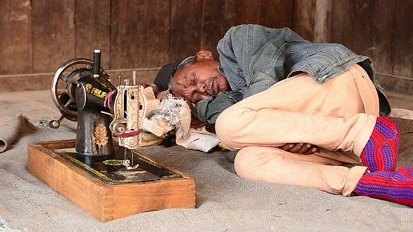 Thumbnail for Seamstress Man Sleeping
