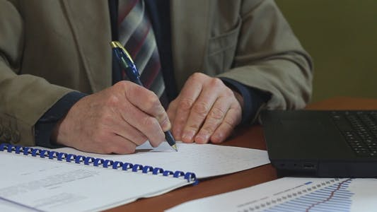 Thumbnail for Businessman Working with Documents