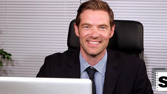 Thumbnail for Smiling Businessman