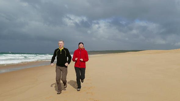 Thumbnail for Middle-aged Couple Jogging on Beach