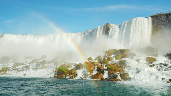 Thumbnail for A Huge Rainbow in the Background Niagara Falls. Lower Angle Shooting From the Niagara River