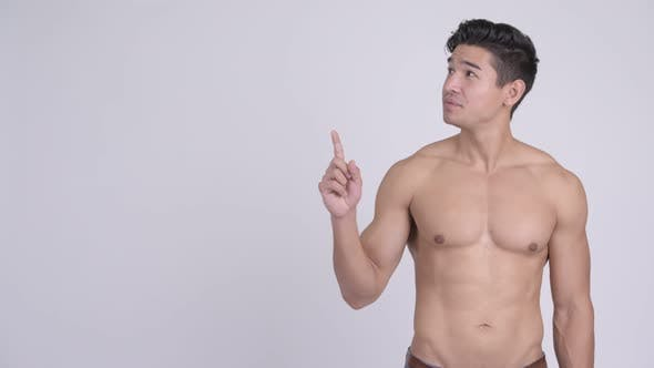 Thumbnail for Happy Young Handsome Muscular Shirtless Man Thinking and Pointing Up