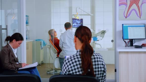 Thumbnail for Patients Sitting on Chairs in Waiting Room of Stomatological Clinic Filling