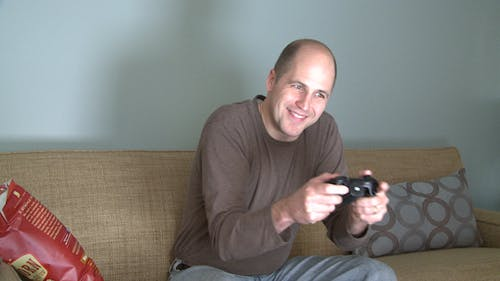 A Man At Home Alone Playing A Video Game (2 Of 2