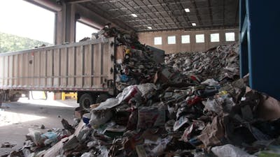 A Truck Dumps Trash To Be Recycled (6 Of 10)