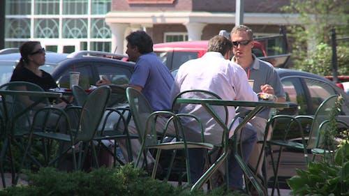 Eating Outside At Sidewalk Cafe