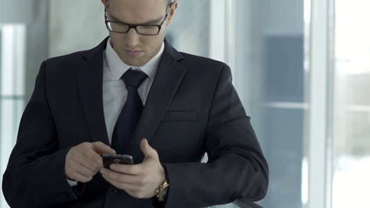 Thumbnail for Businessman Using Mobile Phone