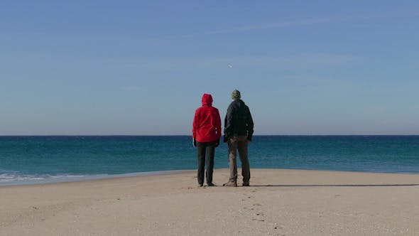 Thumbnail for Happy Middle-aged Couple Walking on Beach