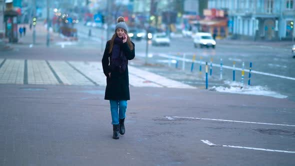 Thumbnail for Girl Walking Down The Street Winter