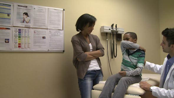 Thumbnail for Mom Watches As Son Get A Checkup (5 Of 8)