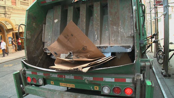 Trash Compactor In Back Of Truck